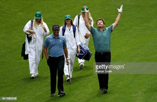 Jon Rahm of Spain walks with Sir Nick Faldo of England during the Par 3 Contest prior to the start of the 2018 Masters Tournament at Augusta National...