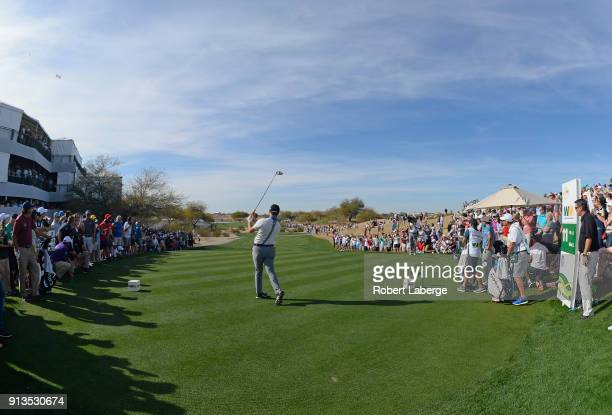 Jon Rahm of Spain watches his tee shot on the 11th hole during the second round of the Waste Management Phoenix Open at TPC Scottsdale on February 2,...