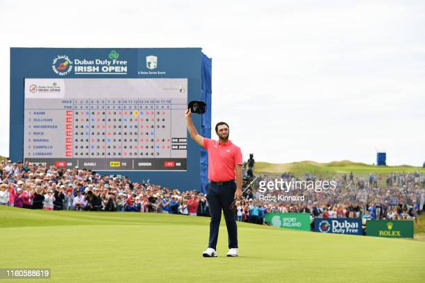 Jon Rahm of Spain waves to the crowd after his putt on the eighteenth hole during Day Four of the Dubai Duty Free Irish Open at Lahinch Golf Club on...