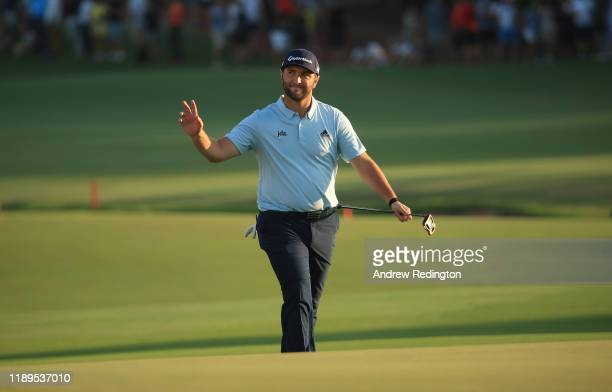 Jon Rahm of Spain waves to the crowd on the 18th hole during Day Three of the DP World Tour Championship Dubai at Jumeirah Golf Estates on November...