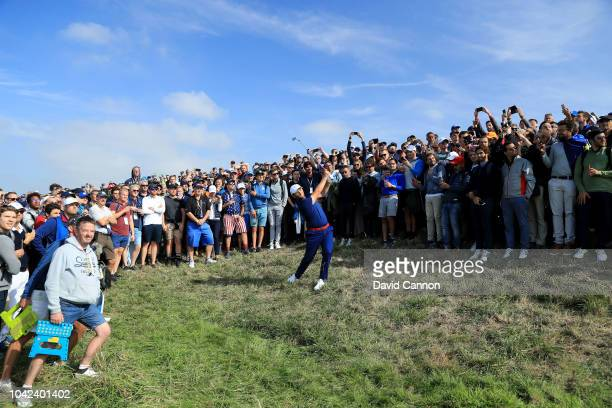 Jon Rahm of the European Team plays his second shot on the 17th hole in his match with Justin Rose against Tony Finau and Brooks Koepka of the United...