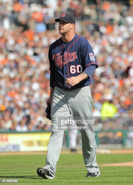 Jon Rauch of the Minnesota Twins walks off the field against the Detroit Tigers during the game at Comerica Park on October 1 2009 in Detroit...