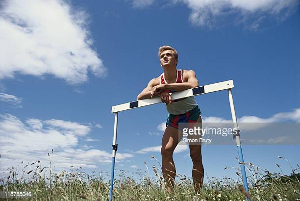 Jon Ridgeon poses with a 110 metres hurdle on 1st June 1988 at Crystal Palace, London, Great Britain.