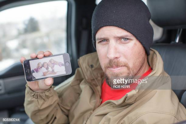 Jon Ritzheimer shows a family picture on his phone to the media at the Malheur National Wildlife Refuge Headquarters near Burns Oregon January 4 2016...