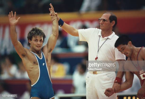 Jon Ronningen of Norway raises his arms in celebration after defeating Atsuji Miyahara of Japan in the Greco-Roman wrestling Flyweight competition...