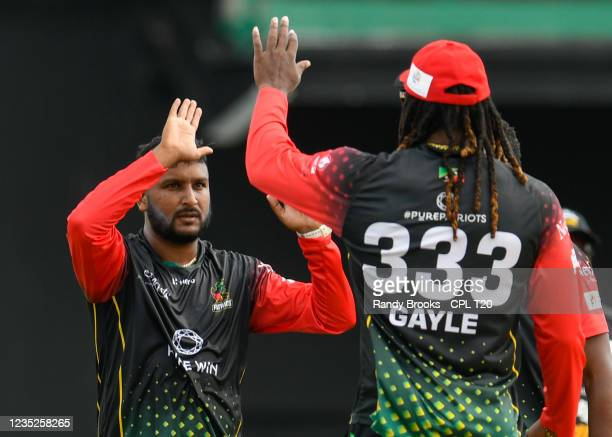 Jon Russ Jaggesar of Saint Kitts & Nevis Patriots celebrates the dismissal of Chanderpaul Hemraj of Guyana Amazon Warriors during the 2021 Hero...