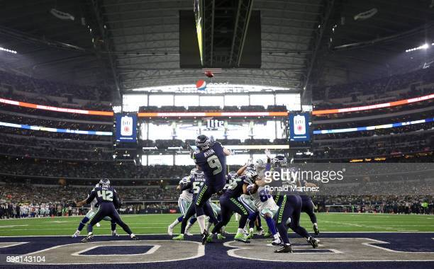 Jon Ryan of the Seattle Seahawks punts the ball against the Dallas Cowboys in the first half at ATT Stadium on December 24 2017 in Arlington Texas