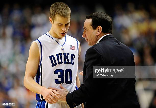 Jon Scheyer and Mike Krzyzewski head coach of the Duke Blue Devils confer against the Georgia Tech Yellow Jackets in the championship game of the...