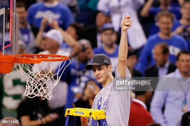 Jon Scheyer of the Duke Blue Devils celebrates after he cut down a piece of the net following their 6159 win against the Butler Bulldogs during the...
