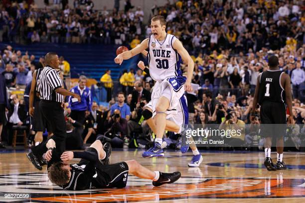 Jon Scheyer of the Duke Blue Devils celebrates after they won 6159 against Matt Howard of the Butler Bulldogs during the 2010 NCAA Division I Men's...