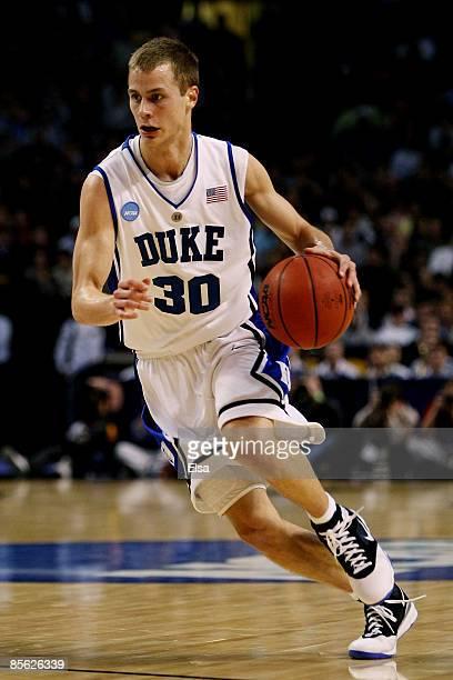 Jon Scheyer of the Duke Blue Devils drives against the Villanova Wildcats during the NCAA Men's Basketball Tournament East Regionals at TD Banknorth...
