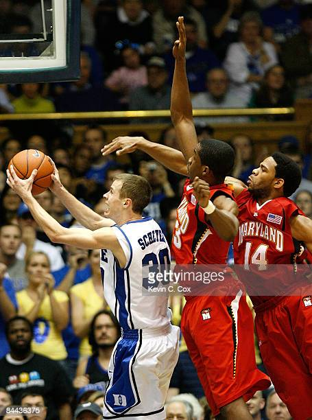 Jon Scheyer of the Duke Blue Devils drives the lane past Dino Gregory and Sean Mosley of the Maryland Terrapins on January 24 2009 at Cameron Indoor...