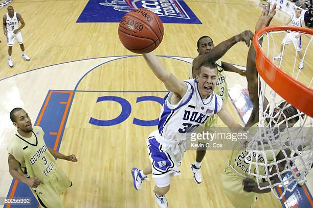 Jon Scheyer of the Duke Blue Devils goes up to shoot against D'Andre Bell of the Georgia Tech Yellow Jackets during day two of the 2008 Men's ACC...
