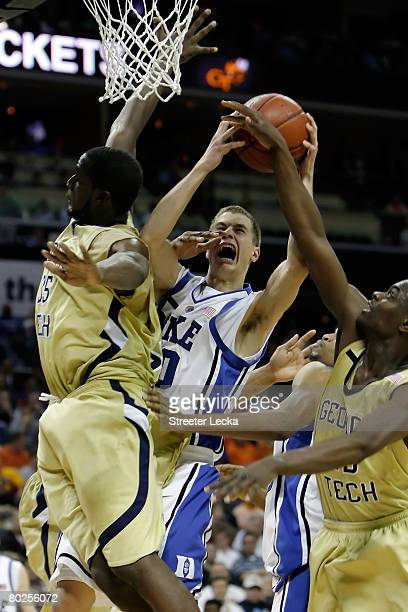 Jon Scheyer of the Duke Blue Devils goes up to shoot against Zack Peacock of the Georgia Tech Yellow Jackets during day two of the 2008 Men's ACC...
