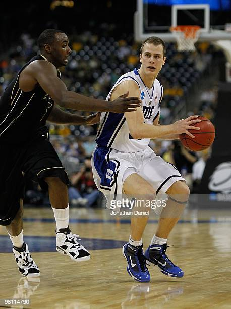Jon Scheyer of the Duke Blue Devils looks to pass under pressure from Keaton Grant of the Purdue Boilermakers during the south regional semifinal of...