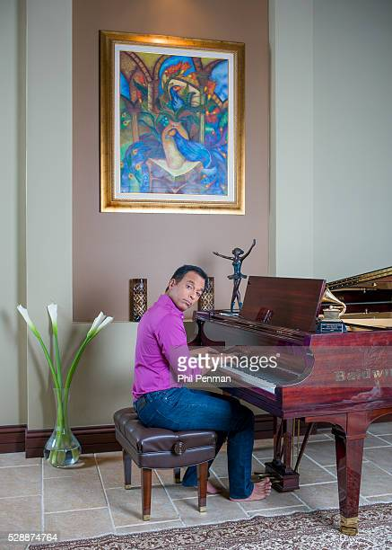 Jon Secada at home in Miami Florida Above the piano where Jon composed much of his latest CD is one of his paintings by a Cuban artist It has imagery...