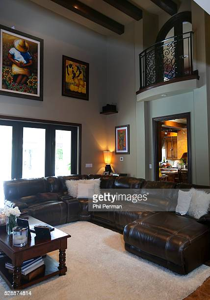 Jon Secada at home in Miami Florida Jon's family room has 30foot high beam ceilings and a practical durable leather sofa It's home central for...