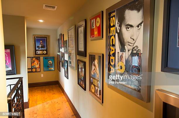 Jon Secada at home in Miami Florida The awardfi lled hallway reminds me of my 25year history in the industry where I started o as a songwriter I feel...