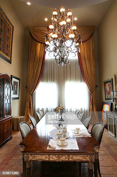 Jon Secada at home in Miami Florida The dining room chandelier also a gift from wife Maritere's parents has a motor so we can lower it