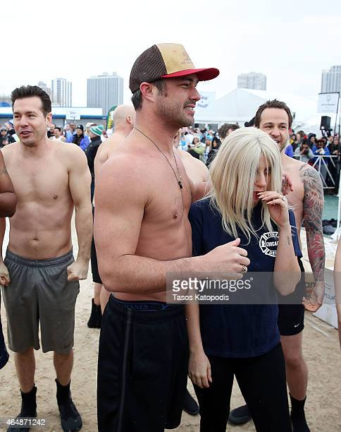 Jon Seda Taylor Kinney and Lady Gaga participates in the Chicago Polar Plunge 2015 at North Avenue Beach on March 1 2015 in Chicago Illinois