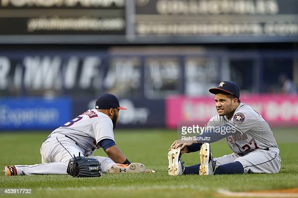 Jon Singleton and Jose Altuve of the Houston Astros stretch before the start of a game against the New York Yankees at Yankee Stadium on August 20...