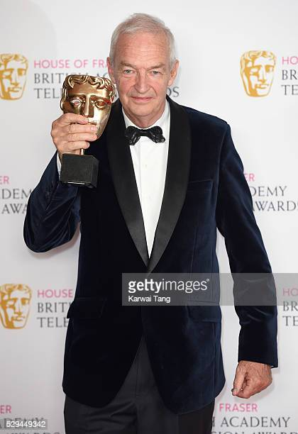 Jon Snow with the award for best news coverage on behalf of Channel 4 poses in the winners room at the House Of Fraser British Academy Television...