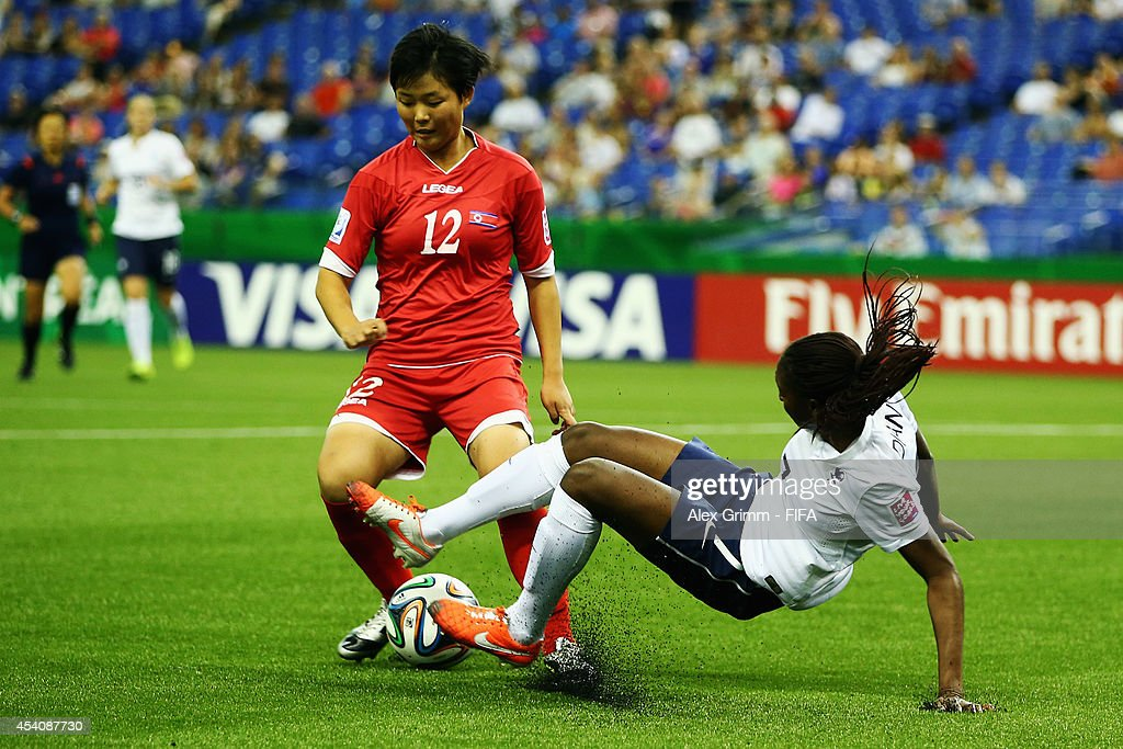 Jon So Yon (L) of Korea DPR is challenged by Kadidiatou Diani of France during the FIFA U-20 Women's World Cup Canada 2014 3rd place match between Korea DPR and France at Olympic Stadium on August 24, 2014 in Montreal, Canada.