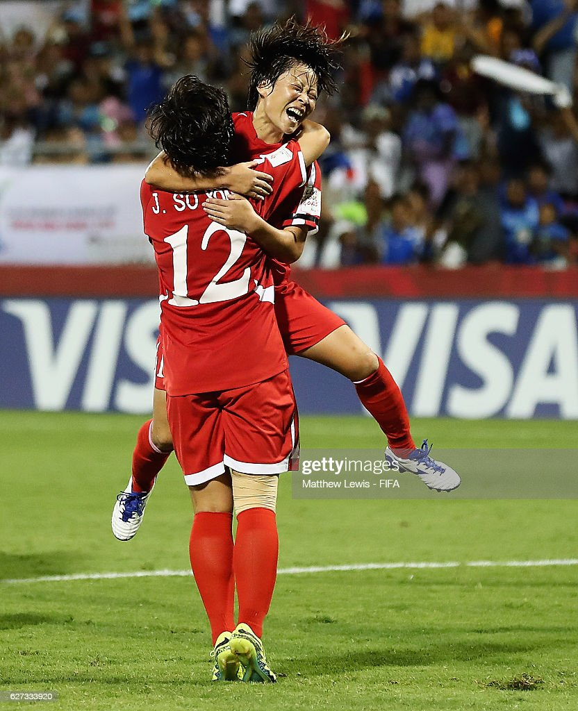 Jon So Yon of Korea DPR is congratulated on her goal during the FIFA U-20 Women's World Cup Papua New Guinea 2016 Final between Korea DPR and France at the National Football Stadiuml on December 3, 2016 in Port Moresby, Papua New Guinea.