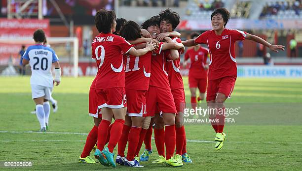 Jon So Yon of Korea DPR is congratulated on her goal from the penalty spot during the FIFA U-20 Women's World Cup Papua New Guinea 2016 Semi Final...