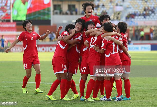 Jon So Yon of Korea DPR is congratulated on her goal from the penalty spot during the FIFA U20 Women's World Cup Papua New Guinea 2016 Semi Final...