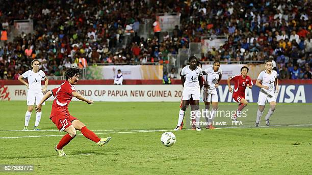Jon So Yon of Korea DPR scores from the penalty spot during the FIFA U20 Women's World Cup Papua New Guinea 2016 Final between Korea DPR and France...
