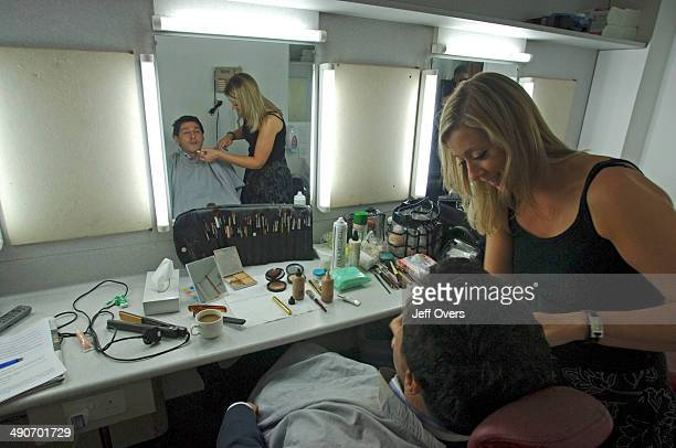 Jon Sopel having makeup applied by makeup makeup artist prior to filming recording the Politics Show Production shot Camera and studio visible