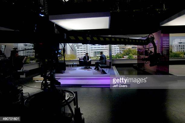 Jon Sopel interviewing guest during the titles sequence on the set of BBC news and current affairs programme The Politics Show Production shot studio...