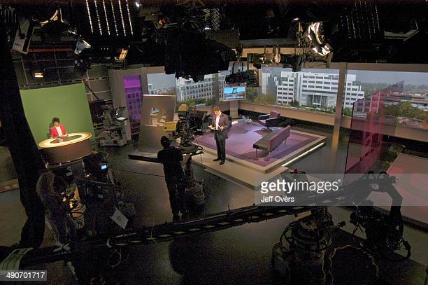 Jon Sopel on the set of BBC news and current affairs programme The Politics Show Production shot studio cameras technical equipment lamps lighting...