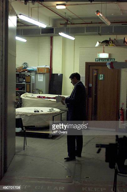 Jon Sopel preparing reading script in a corridor outside the set prior to recording filming the BBC news and current affairs programme The Politics...
