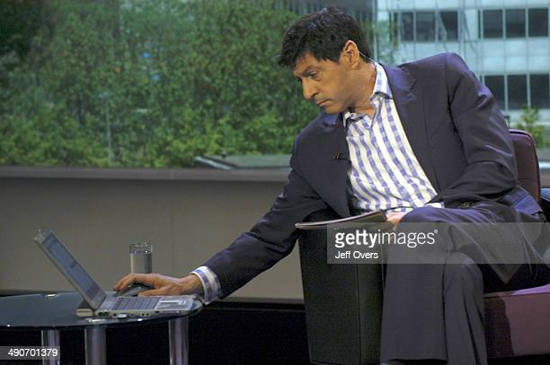 Jon Sopel uses a laptop computer on the set of BBC news and current affairs programme The Politics Show