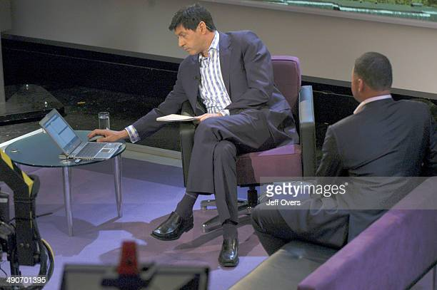 Jon Sopel uses a laptop computer on the set of BBC news and current affairs programme The Politics Show Other man is currently unidentified