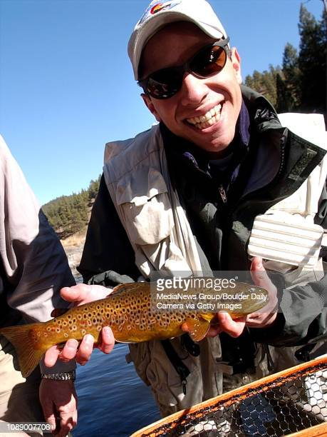 Jon Spiegel holds about a sixteen inch brown trout taken on a small midge pattern in Cheesman Canyon on the South Platte River on a recent weekday....