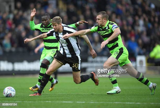 Jon Stead of Notts County battles with Drissa Traore and Lee Collins of Forest Green Rovers during the Sky Bet League Two match between Notts County...