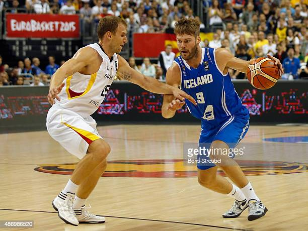 Jon Stefansson of Iceland drives to the basket against Anton Gavel of Germany during the FIBA EuroBasket 2015 Group B basketball match between...