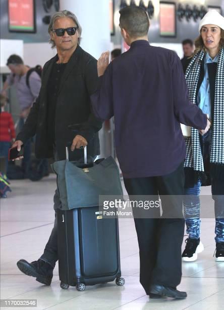 Jon Stevens and Heloise Pratt are seen departing Perth Airport on August 25 2019 in Perth Australia