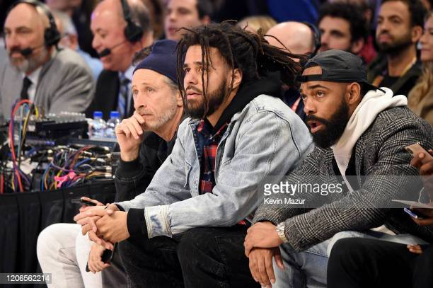 Jon Stewart and J Cole attend 2020 State Farm AllStar Saturday Night at United Center on February 15 2020 in Chicago Illinois