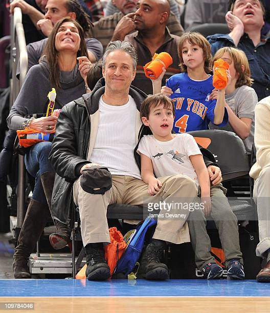 Jon Stewart and son Nathan Thomas Stewart attend the Cleveland Cavaliers vs New York Knicks game at Madison Square Garden on March 4 2011 in New York...