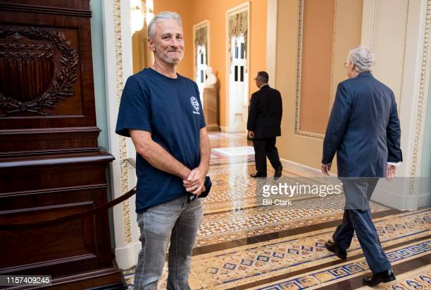 Jon Stewart former host of The Daily Show smiles as Senate Majority Leader Mitch McConnell RKy walks by at the Ohio Clock Corridor in the Capitol on...