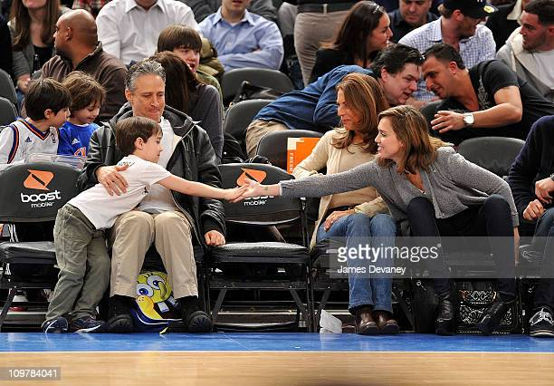 Jon Stewart Nathan Thomas Stewart and Jessica Alba attend the Cleveland Cavaliers vs New York Knicks game at Madison Square Garden on March 4 2011 in...