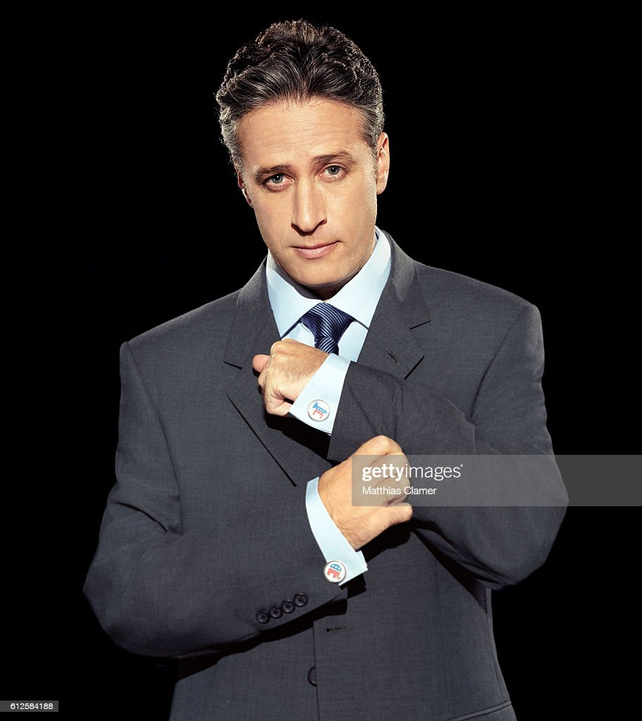 Jon Stewart prepares for the 2004 Presidential Election by wearing a Democratic donkey cuff link and a Republican elephant cuff link.