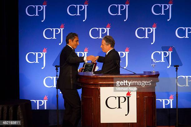 Jon Stewart presents Egyptian satirist Bassem Youssef an award at the Committee to Protect Journalists' International Freedom Awards at the Waldorf...