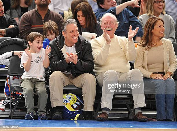 Jon Stewart with son Nathan Thomas Stewart and Butch Trucks attend the Cleveland Cavaliers vs New York Knicks game at Madison Square Garden on March...