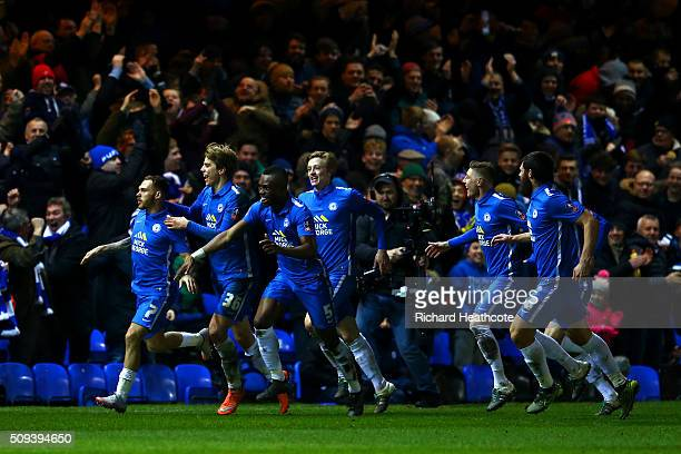 Jon Taylor of Peterborough celebrates with teammates after scoring the opening goal during the Emirates FA Cup fourth round replay match between...