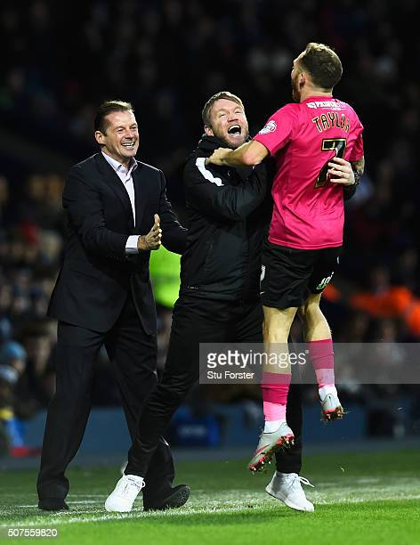 Jon Taylor of Peterborough United celebrates scoring his team's second goal with manager Graham Westley and staff during the Emirates FA Cup Fourth...